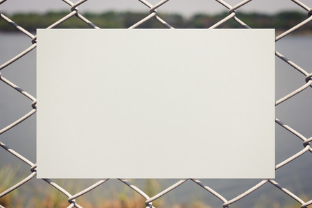 college ruled: Paper on metal fence Stock Photo