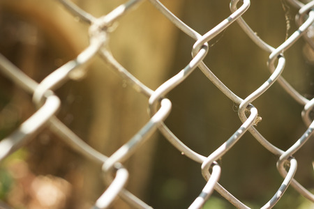 perimeter: Wire fence with futsal field on background