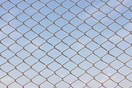 detain: Wire fence with futsal field on background
