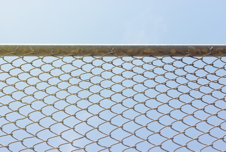 enclosures: Wire fence with futsal field on background  Stock Photo