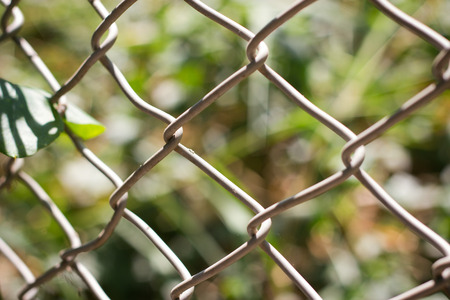 chainlink: Wire fence with futsal field on background