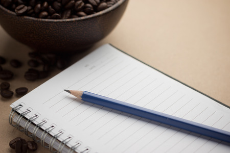 treatise: Pencil Laying On A Notebook Stock Photo