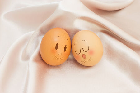 peek: Eggs in Expression Face on satin and Colorful Background Stock Photo