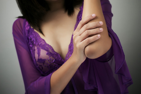 elbow pain: Adult woman with elbow pain Stock Photo