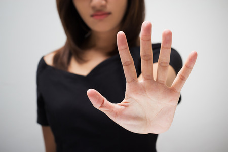 failing: Young woman showing her denial with NO on her hand Stock Photo