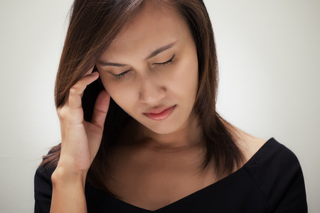 ordeal: Portrait of stressed business woman with a headache