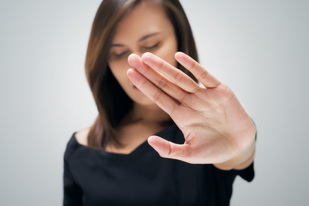 stop: Young woman showing her denial with NO on her hand Stock Photo