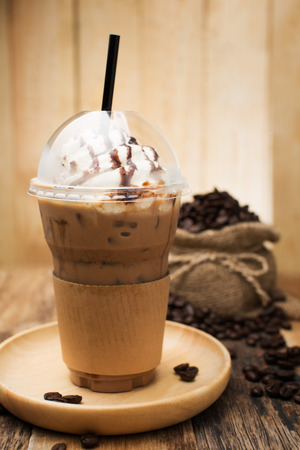 blended: Iced coffee with straw in plastic cup Stock Photo