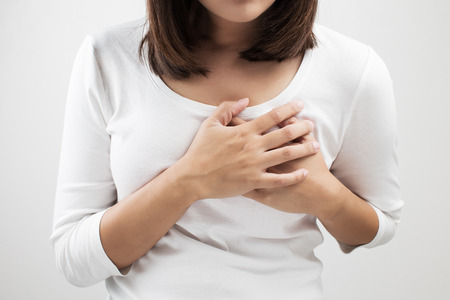 women breast: Woman having a pain in the heart area Stock Photo