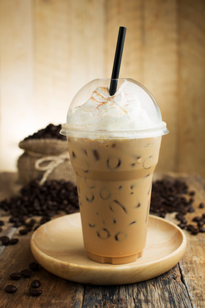 ice cream bar: iced cappuccino with straw in plastic cup