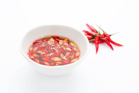 nam: Thai fish Sauce in a cup on white background