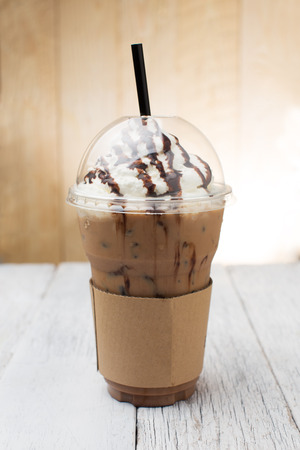 iced coffee: iced coffee with straw in plastic cup Stock Photo