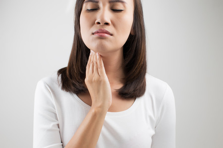 gland: Sore throat woman Stock Photo