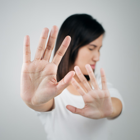 no entry: Young woman showing her denial with NO on her hand Stock Photo