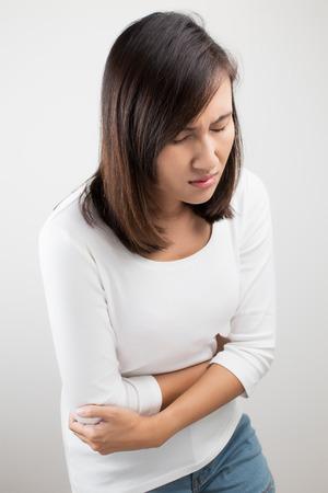 belly ache: Woman heaving belly ache Stock Photo