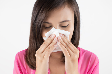 sinus: Flu cold or allergy symptom. Sick woman girl sneezing in tissue on blue. Health care.