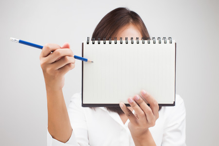 summaries: Business woman holding a book on white background