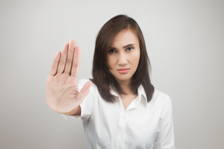 rejection sad: Young woman showing her denial with NO on her hand Stock Photo