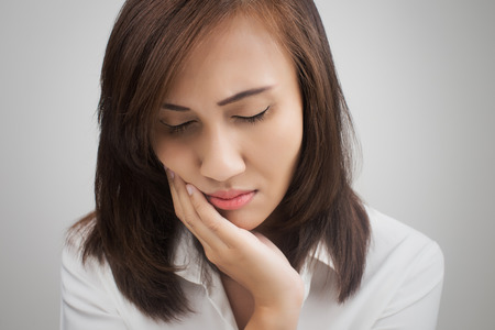 woman in pain: Have a toothache