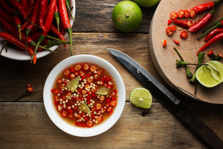 Thai fish Sauce in a cup on wood background Stockfoto
