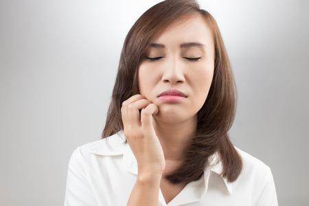 Young beautiful woman scraching her labia