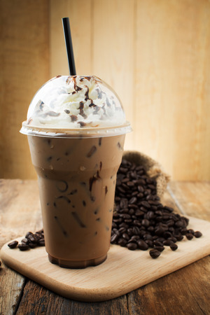 iced mocha with straw in plastic cup Stock Photo