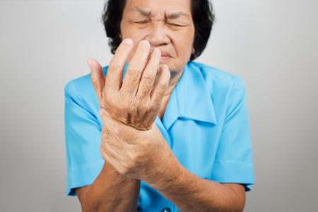 asia nude: Acute pain in a senior woman wrist