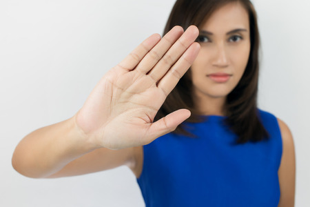 to restrain: Young woman showing her denial with NO on her hand Stock Photo