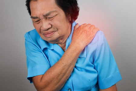 hurt: Woman with shoulder pain