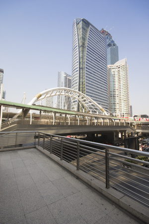 in copula: BANGKOK -JAN 28: View of high buildings and public sky walk for transit between Sky Transit and Bus Rapid Transit Systems at Sathorn-Narathiwas junction on JAN 28, 2016 in Bangkok,