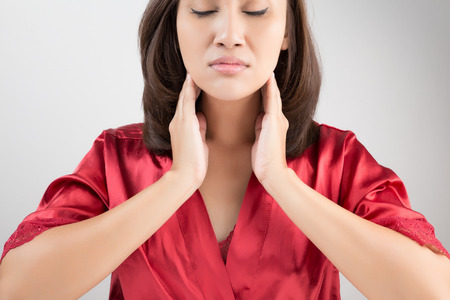 swollen: Sore throat woman on white background