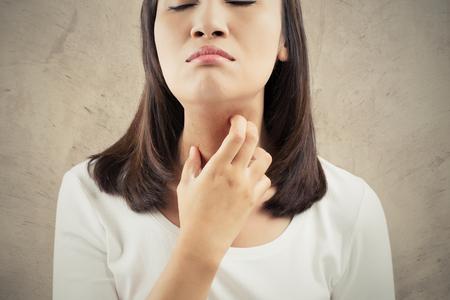 Woman scratching her neck 写真素材