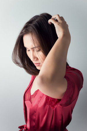 atopic: itchy scalp, itching In A Woman Stock Photo