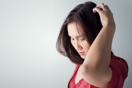 scalp: itchy scalp, itching In A Woman Stock Photo