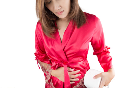 constipation symptom: Woman having painful stomachache on white background