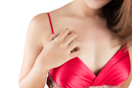 Woman scratching her itchy chest, isolate on white background