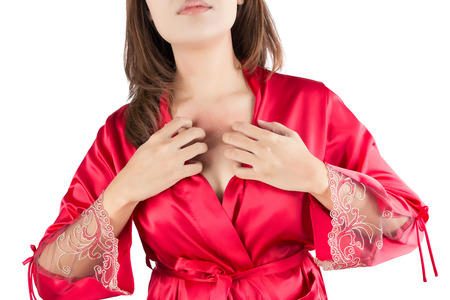 itchy: Woman scratching her itchy chest, isolate on white background