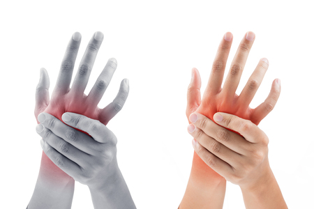 sprained joint: Woman massaging her painful hand on white background Stock Photo