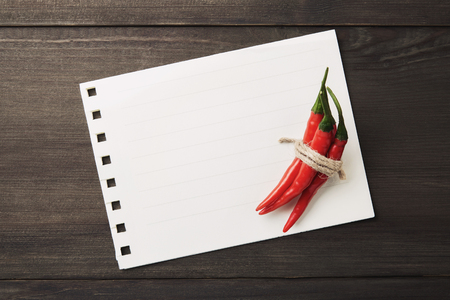 describe: Red Hot Chili Peppers on the Old Paper sheet Stock Photo