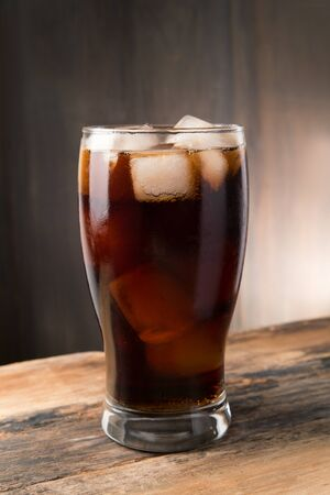 glass cup: Cold fizzy cola soda with ice in glass cup Stock Photo