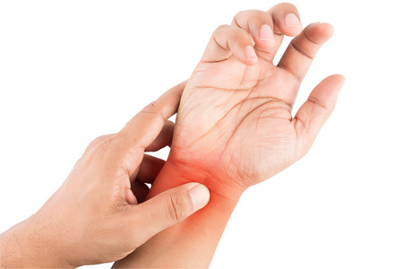 Woman massaging her painful hand on white background Stock Photo