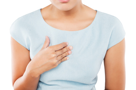 Woman suffering from acid reflux or heartburn, isolated on white background Foto de archivo