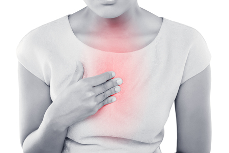 acid reflux: Woman suffering from acid reflux or heartburn, isolated on white background Stock Photo