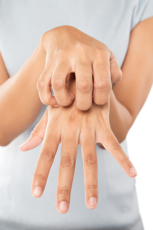 Lady scratch the itch with hand, Wrist, Itching, Concept with Healthcare And Medicine. Stock Photo