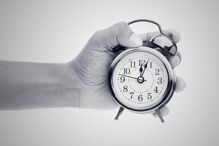 backlog: Man hands holding big round clock, isolated on white Stock Photo
