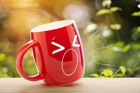 Red coffee cup empty front porch the morning. Good morning or Have a happy day message concept