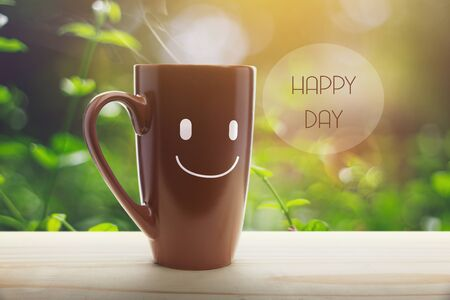 Brown mug of coffee with a happy smile