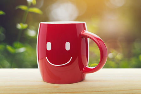 lucky break: Brown mug of coffee with a happy smile