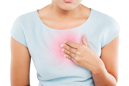 Woman suffering from acid reflux or heartburn, isolated on white background Stock Photo