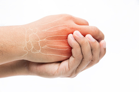 Man massaging painful wrist on a white background. Pain concept Standard-Bild